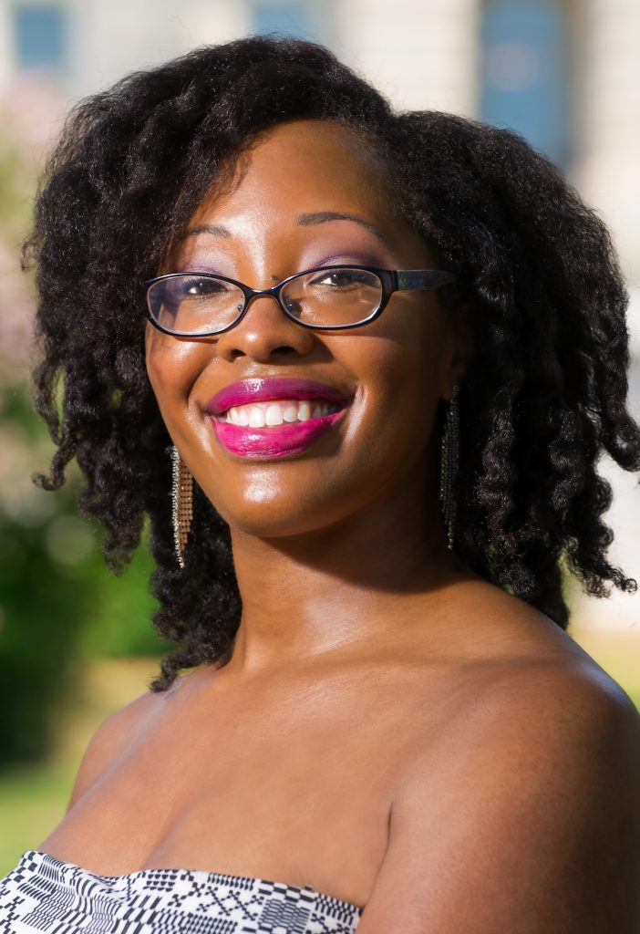 Author Jayce Ellis, with absolutely gorgeous hot pink lipstick and a killer twistout